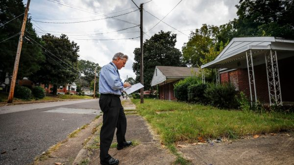 Steve Shular, City of Memphis special assistant for neighborhood concerns, surveyed vacant homes and blighted areas last week on Red Oak Street in Binghampton. (Mark Weber/Daily Memphian)