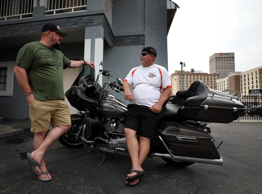 Biking from Tulsa, Okla., to the Great Smoky Mountains National Park, Jerrod Horton and Frank Cypert chat on Aug. 9, 2019, at the Vista Inn. They were two of the last guests to stay at the motel on Union Avenue in Downtown Memphis. The inn closed its doors on Aug. 14 to make way for the Union Row development. (Patrick Lantrip/Daily Memphian)