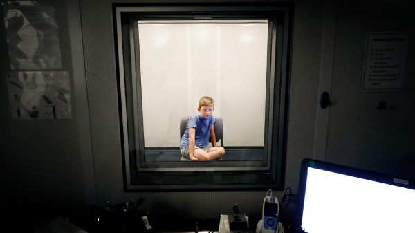 Charlie Wall, 8, takes part in a hearing test at the University of Memphis Speech and Hearing Clinic, Wednesday, July 17, 2019. Doctors at the U of M are conducting research to help kids who can hear, but whose brains can't process what their ears collect. (Mark Weber/Daily Memphian).