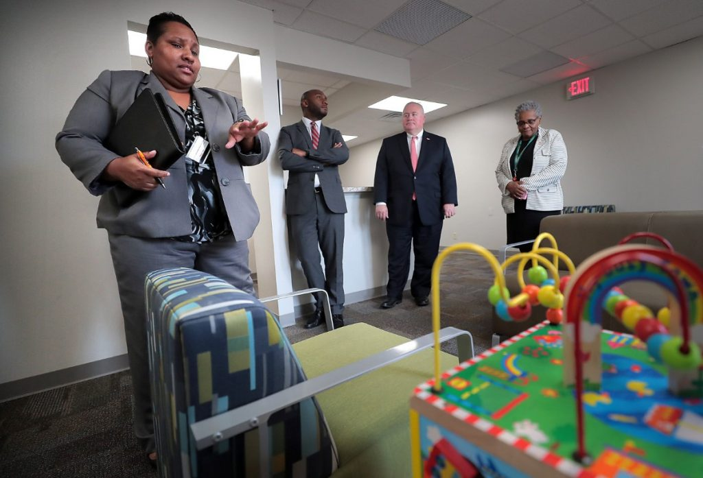 Dr. Altha Stewart (far right) and  Kena Vassar (far left) guide Shelby County Mayor Lee Harris (center) and Commissioner Mark Billingsley through a tour of the new Youth Advocacy Center on August 13, 2019. The center is a pilot program that will try to keep young people out of the juvenile justice system through mental health evaluation and intervention. (Jim Weber/Daily Memphian)