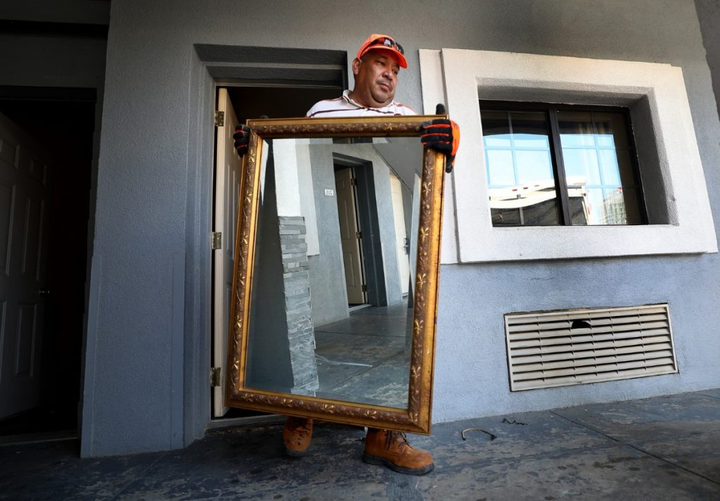 Louis Hernandez carries out the last few items in at the Vista Inn & Suites in Downtown Memphis on Aug. 15, 2019, as the long-standing motel closes to make way for the massive Union Row development. (Patrick Lantrip/Daily Memphian)