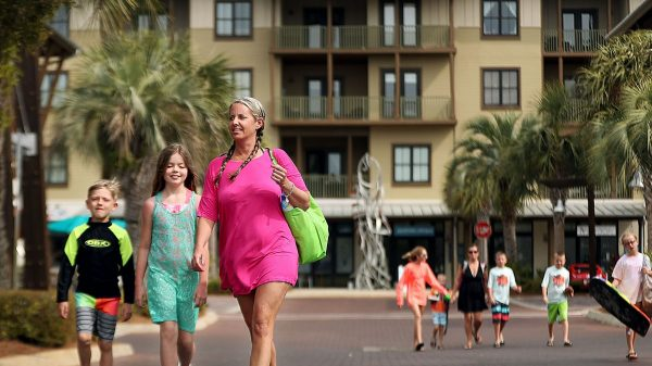 Mary Lester and her children Clint and Bella head to the nearby beach during their vacation in April at the Redfish Village condos at Blue Mountain Beach, Florida. (Patrick Lantrip/Daily Memphian)