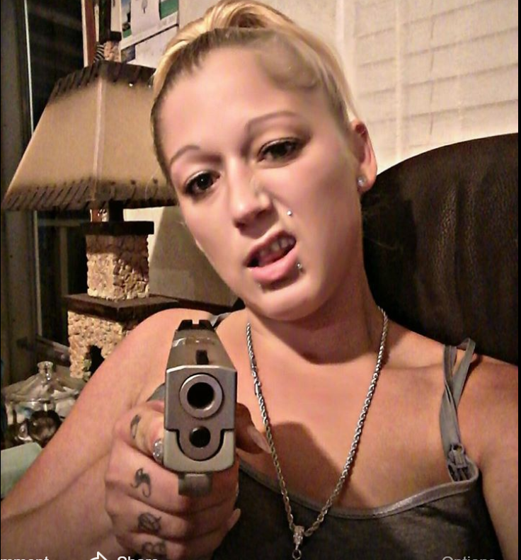 A Facebook image shows Bridgett Stafford aiming a gun at the camera.