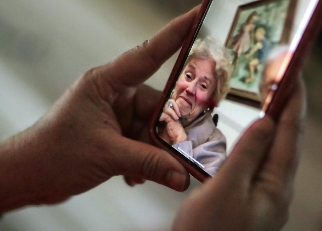 Whitney Miller talks with her mother Greene Miller during a Facetime call from her East Memphis home on May 1, 2020. The Millers are residents at the Village at Germantown. (Jim Weber/Daily Memphian)
