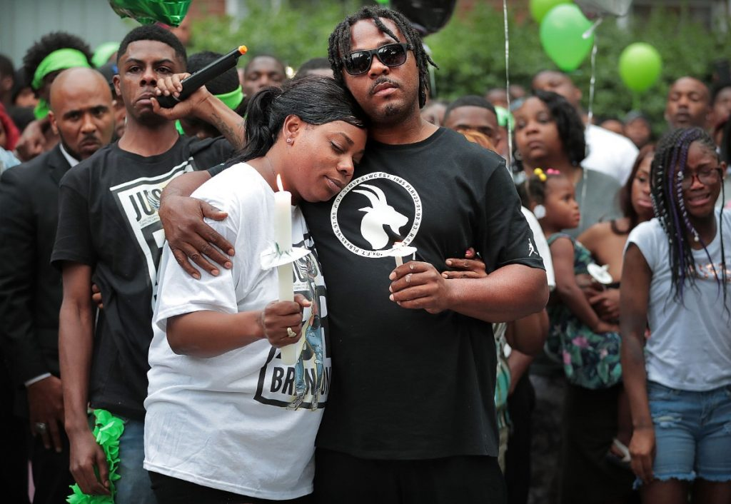 On June 12, 2019, Carlos Clark (center) holds his sister Jaleta Clark, mother of 20-year-old Brandon Webber, who was shot by U.S. Marshals in Frayser. (Jim Weber/Daily Memphian)