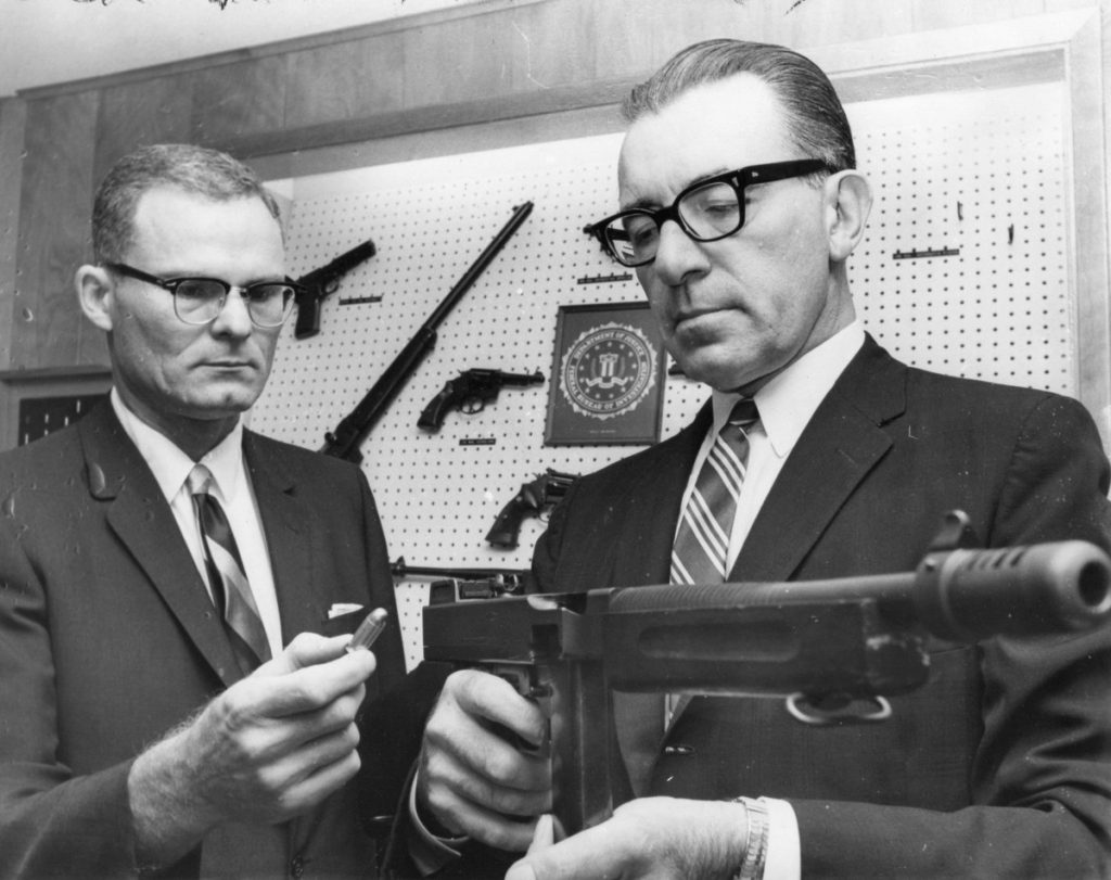<span><strong>FBI special agent William H. Lawrence (left),pictured in 1965 with agent E. Hugo Winterrowd, recruited civil rights photographerErnest Withers, who then collaborated with the bureauas a paid informant keeping watch over the civil rights movement.</strong>(CourtesyPreservation and Special Collections Department, University Libraries, University of Memphis – Press Scimitar collection)</span>