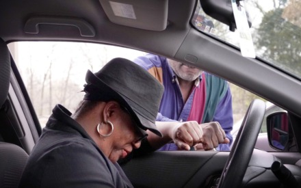 """Joyce Hamilton (in car) stopped by the Holy City Church of God in Christ in Memphis on March 19, 2020, to ask for prayers of encouragement with church Elder Mark Walker at the Raleigh church's """"drive-thru prayer."""" (Karen Pulfer Focht/Special to The Daily Memphian)"""