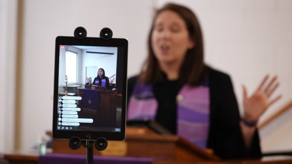 Rev. Sara K. Corum, pastor at Trinity United Methodist Church in Memphis, preaches to her congregation in a live stream on Sunday morning, March 22, 2020, from an empty room in her midtown church. The church was closed to worshippers due to the spreading Coronavirus Covid 19. (Karen Pulfer Focht/Special to the Daily Memphian)
