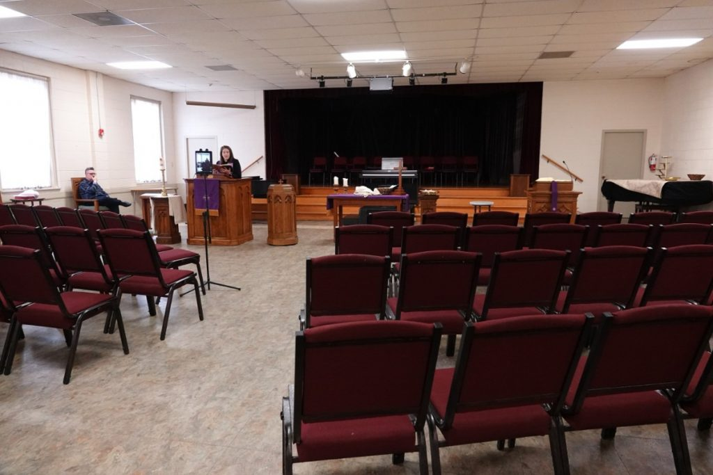Rev. Sara K. Corum, pastor at Trinity United Methodist Church in Memphis, preaches to an empty room as her sermon is live-streamed from the Midtown church. (Karen Pulfer Focht/Special to the Daily Memphian)
