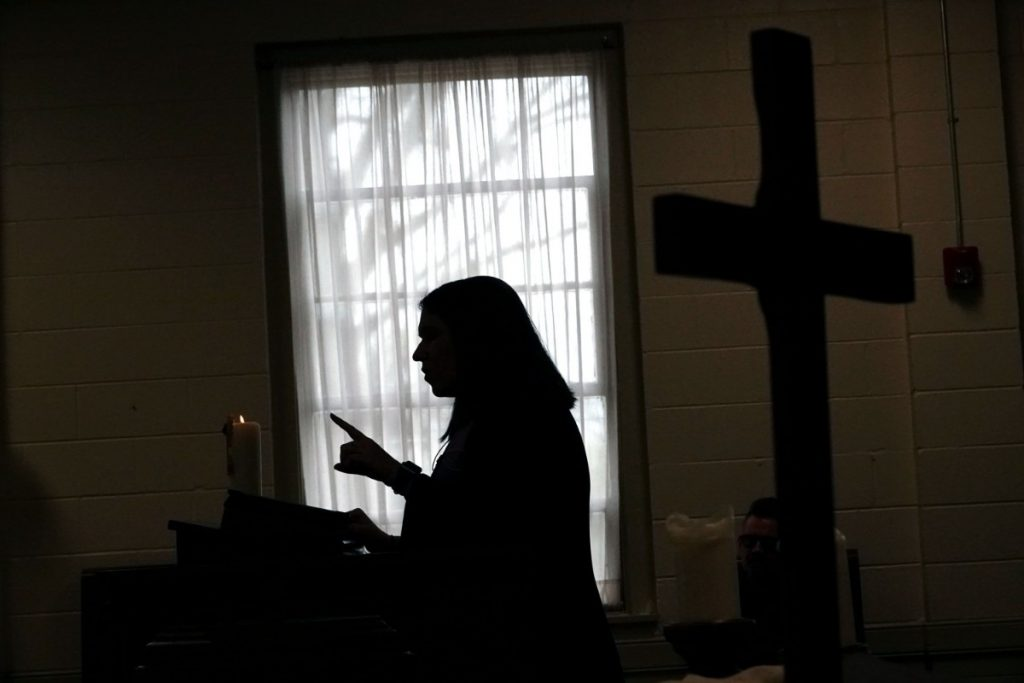Rev. Sara K. Corum, pastor at Trinity United Methodist Church in Memphis, preaches to her congregation in a live stream on Sunday morning, March 22, 2020, from an empty room in her Midtown church. (Karen Pulfer Focht/Special to the Daily Memphian)