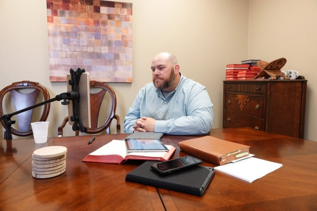 Since internet reception is poor at his rural church, Shiloh United Methodist Church in Somerville, Tenn., Rev. Josh McClurkan preaches to his congregation in a livestream on Sunday morning, March 22, 2020, from his wife's Midtown church. (Karen Pulfer Focht/Special to the Daily Memphian)