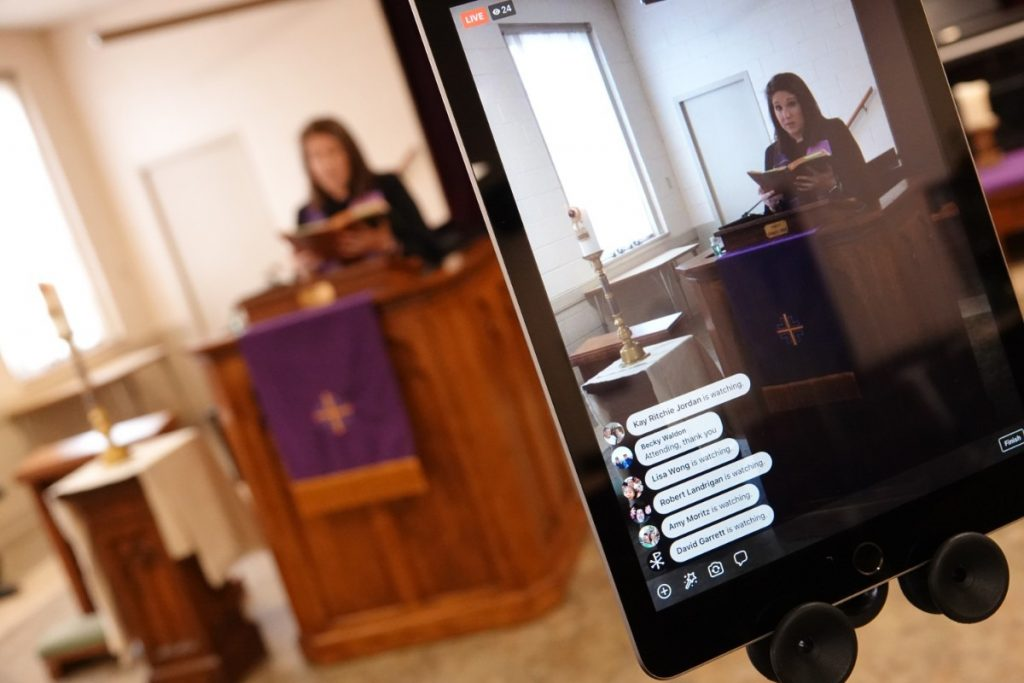 The names of some people watching the Sunday, March 22 sermon are visible on the screen as Rev. Sara K. Corum preaches at Trinity United Methodist Church in Memphis.  (Karen Pulfer Focht/Special to the Daily Memphian)