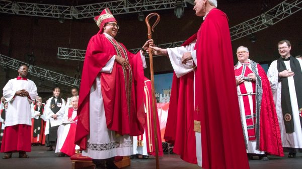 The Rt. Rev. Phoebe A. Roaf receives her crozier from Bishop Don Johnson during her consecration as Fourth Bishop of the Episcopal Diocese of West Tennessee on May 5, 2019, at Hope Church. (Lisa Buser/Daily Memphian file)
