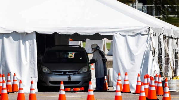 Staff and students from the University of Tennessee Health Science Center work with the Shelby County Health Department on Wednesday, April 1, 2020, to continue drive-thru testing for COVID-19 at the Memphis Fairgrounds. (Mark Weber/ The Daily Memphian)