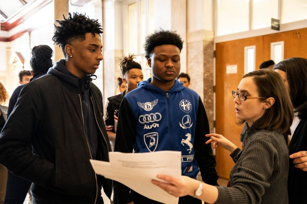 """Teacher Bridget Riley talks to East High School students after a screening of """"Me and the Light"""" at the Malco Paradiso earlier this year. (Photo by Andrea Morales)"""