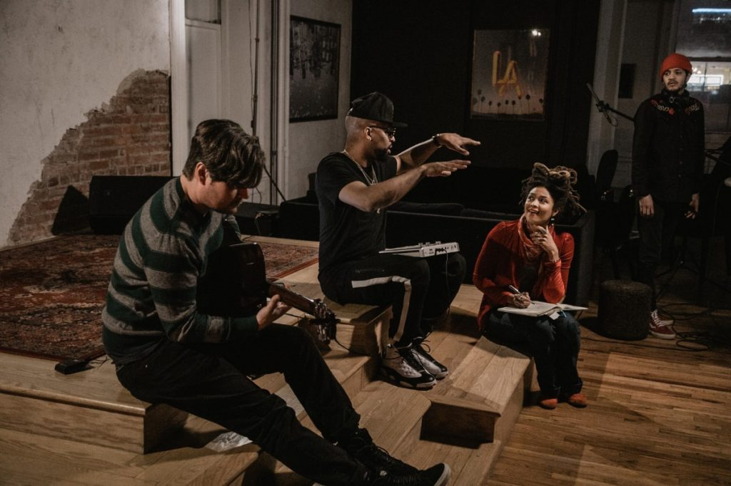 """Musicians Paul Taylor (from left), Christopher """"Drumma Boy"""" Gholson and Valerie June work together to create a song for a video introduction about the Grounded team. (Photo by Kyle Buthod)"""