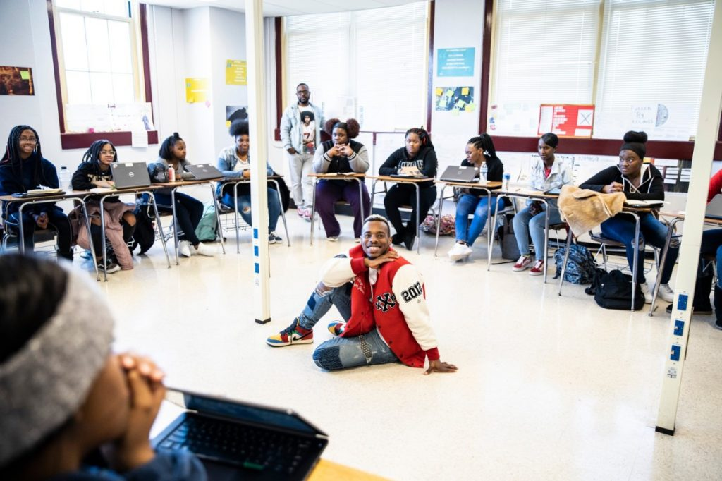 Grounded team members, left to right, Marico Flake (standing) and Lil Buck (sitting) participate in a reflection exercise with students at East High School on January 27th, 2020. (Photo by Andrea Morales)