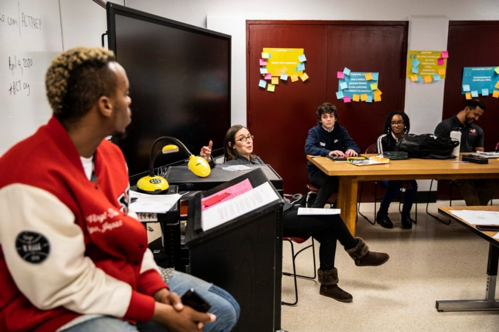 """East High Teacher Bridget Riley (center) talks with students during her restorative justice class on January 27th 2020. Riley and a group of students including Azaria Boyd, Tadavion Jones, Seth Jones, Eryn Hollomon and Sydney Marshall were instrumental advocates in bringing the """"Me and the Light"""" film and curriculum to East High. (Photo by Andrea Morales)"""