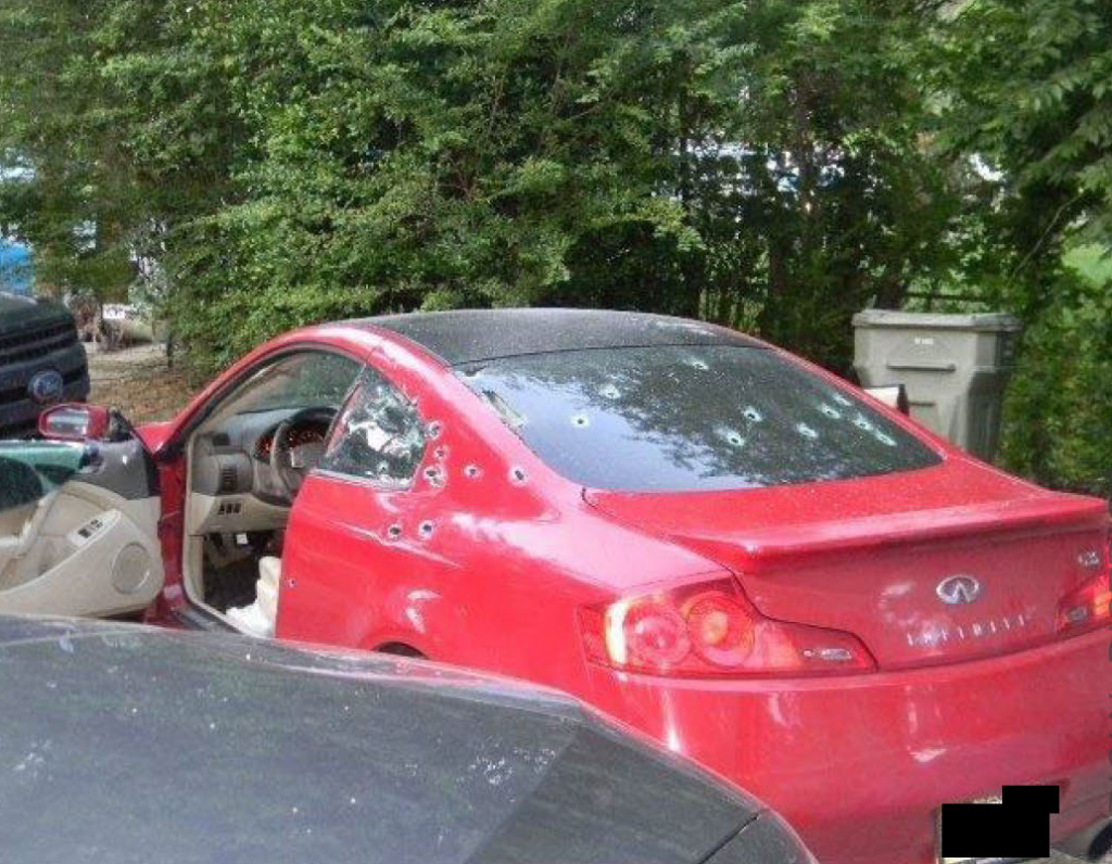 Bullet holes from shots fired by a U.S. Marshal's fugitive squad pock a red Infiniti sports coup that Brandon Webber was driving on June 12, 2019 when he was shot and killed by officers. Webber had been accused of stealing the car and shooting its owner, leaving him for dead. (Photo courtesy of Tennessee Bureau of Investigation)