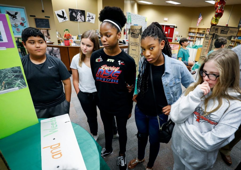West Collierville Middle students listened to classmates explain their science fair projects during a Agri-STEM career day Friday, Sept. 20, 2019. Most suburban schools' plans for notifying families who child has been exposed to coronavirus are unclear. (Mark Weber/Daily Memphian)