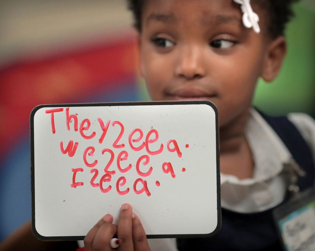 Payton Swayzer copies sentences onto a dry erase board during a small-group writing assignment in Michelle Biggs' kindergarten class at Keystone Elementary School on April 12, 2019. (Jim Weber/Daily Memphian)