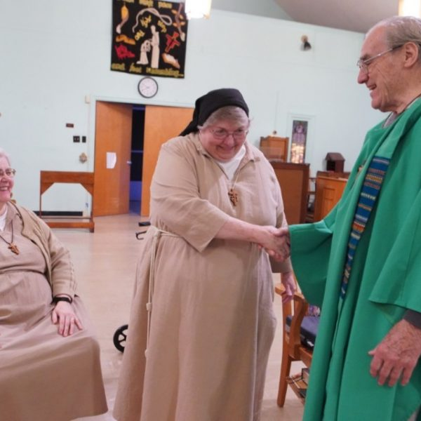 Father David Knight celebrates with the Poor Clare's of Memphis one of their last masses together in the private chapel on Nov. 20, 2019. This was shortly before the Monastery of St. Clare closed at the end of 2019. (Karen Pulfer Focht/Special to The Daily Memphian)
