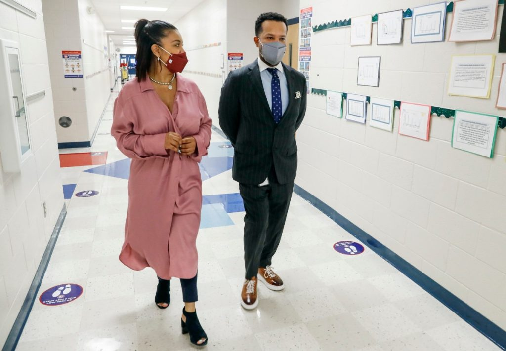Shelby County Schools' Chief Academic Officer Dr. Antonio Burt chats with Brewster Elementary Principal Dr. Angela Askew while attending classes at the school on Tuesday, April 27, 2021. (Mark Weber/The Daily Memphian)