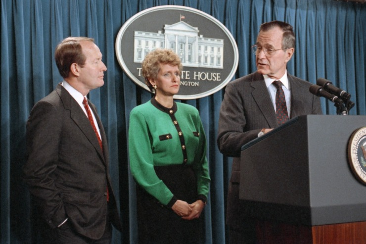 U.S. President George H. Bush glanced toward his choices for two Cabinet positions during a White House press briefing, Monday, Dec. 18, 1990, in Washington. At left is former Tennessee Gov. Lamar Alexander, the President's pick for education secretary. Outgoing Illinois Rep. Lynn Martin, center, was chosen by Bush to be labor secretary. (Marcy Nighswand/AP file)