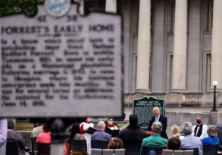 Tim Huebner speaks at a rededication of a plaque noting the location of the Downtown slave market owned by Nathan Bedford Forrest April 7. The marker was erected as a response to a 1950s-era historical marker that failed to mention how Forrest made his fortune. (Patrick Lantrip/Daily Memphian)