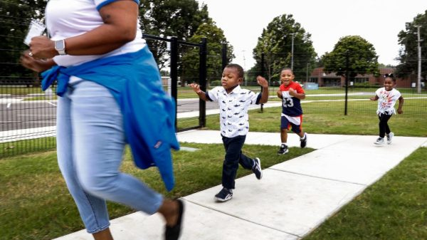 Porter-Leath Early Childhood Academy students (left to right) Marlen W., Ethan H. and Rayne H. run around the playground on Tuesday, July 13, 2021 in Frayser. (Mark Weber/The Daily Memphian)