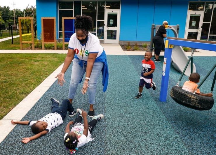 Porter-Leath Early Childhood Academy teacher Donna Jackson (middle) plays with students.(Mark Weber/The Daily Memphian)