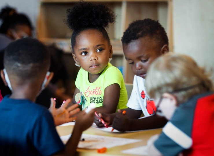 Porter-Leath Early Childhood Academy student Wynter J., 3, colors with her classmates.(Mark Weber/The Daily Memphian)